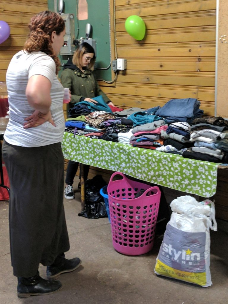 A heap of clothing to browse and donate back to YWCA